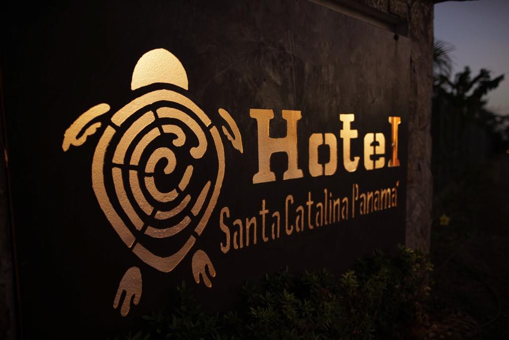 Logo imagen of the hotel Santa Catalina in the entrance. It's a bright sign at night.